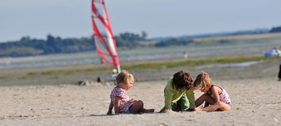 Sandy beach with plenty of room to build sandcastles, play beach games...
