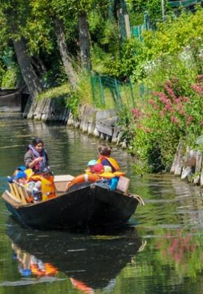 Visit the floating gardens in a peaceful boat ride