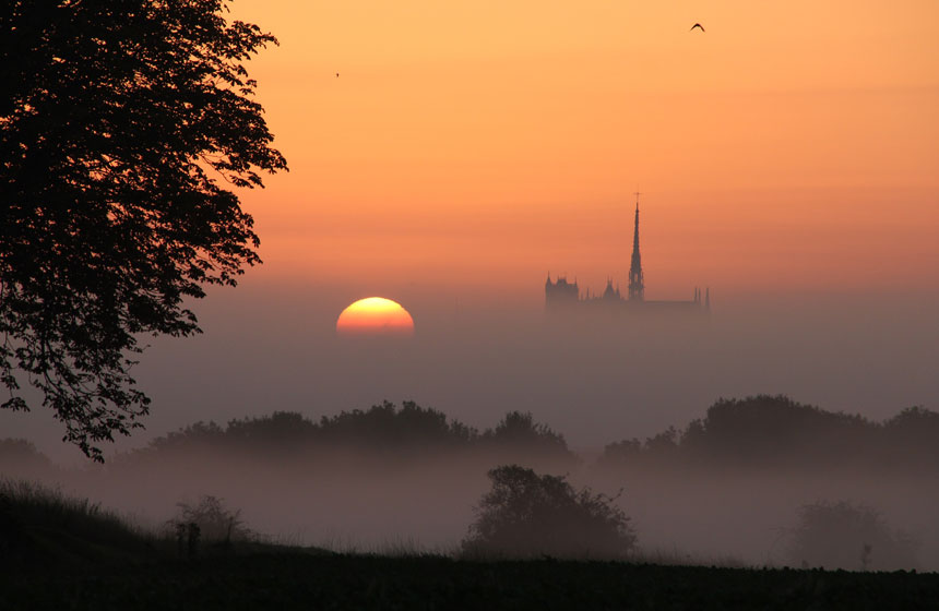 Watch the sun setting over Amiens cathedral on your romantic weekend break in Northern France
