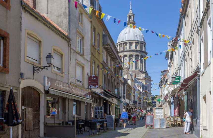 Visit Boulogne sur Mer for its seafood restaurants, its markets and the cobbled streets of its fortified town