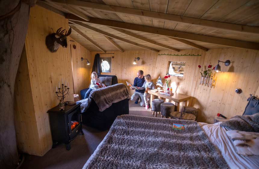 Decor on your family treehouse holiday in France is beautifully rustic yet modern and comfortable at the same time