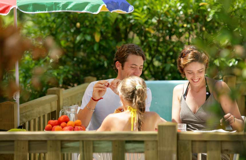 Alfresco dining on your family weekend break at Camping Ferme des Aulnes