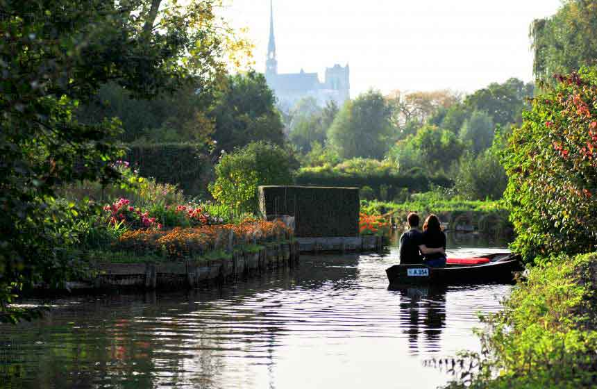 Hire a boat to explore Amiens' unique floating gardens, known as the 'Hortillonnages'