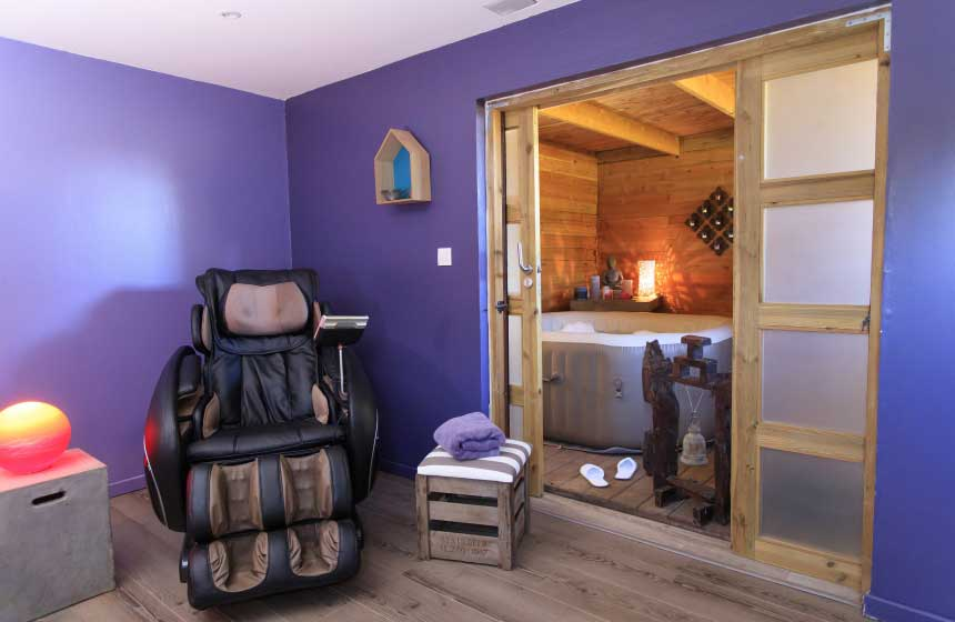 Spa space with massage chair at the Lodges de Malbrough