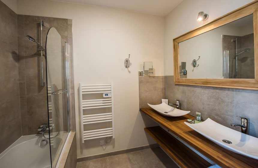 Bathrooms at Hôtel Le Chantilly in Northern France have a contemporary and luxury feel