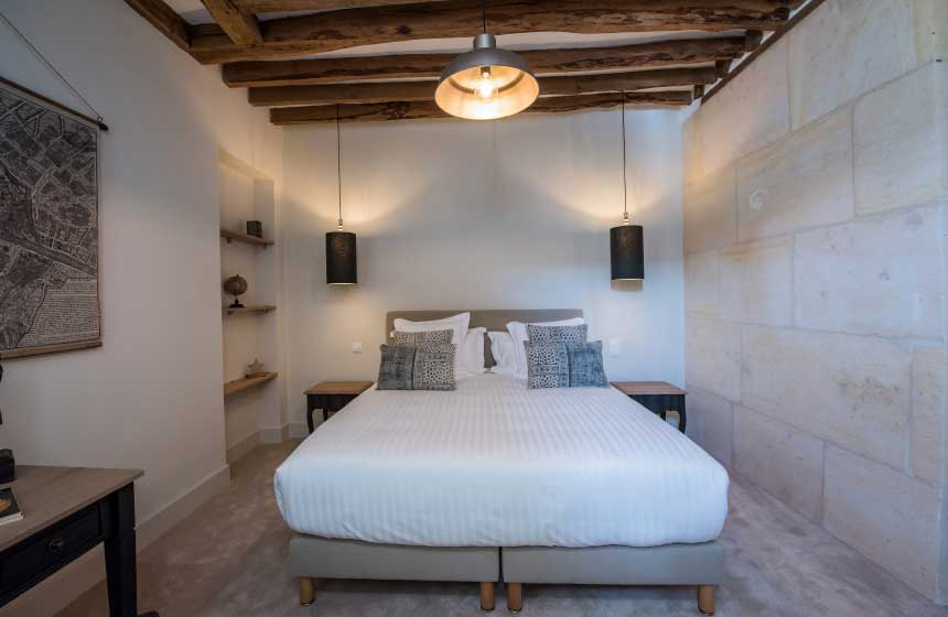 One of the bedrooms at Hôtel Le Chantilly oozing character and understated French elegance