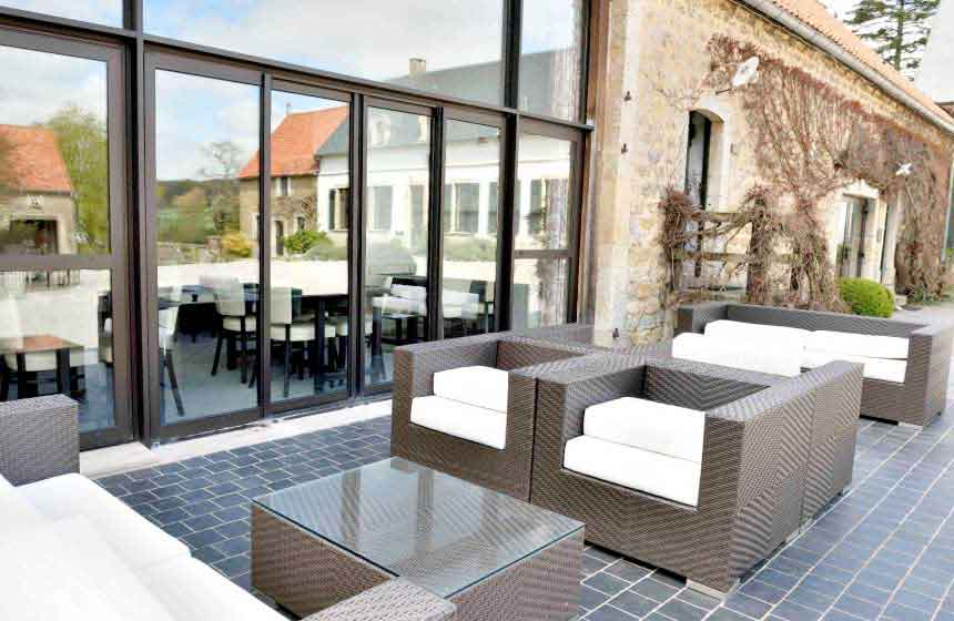 Chic outdoor terrace at Ferme du Vert, a hotel near Calais that's easily accessible from the A16 motorway in Northern France