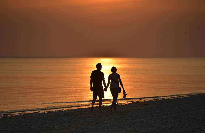 Press the stop button on life to enjoy a romantic beach walk and sunset in Northern France