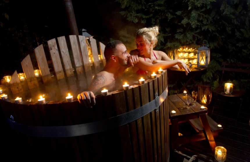 Guests can't wait to try out the Nordic spa on their gypsy caravan holiday ‒ effectively a hot tub but wooden so blending more seamlessly with nature