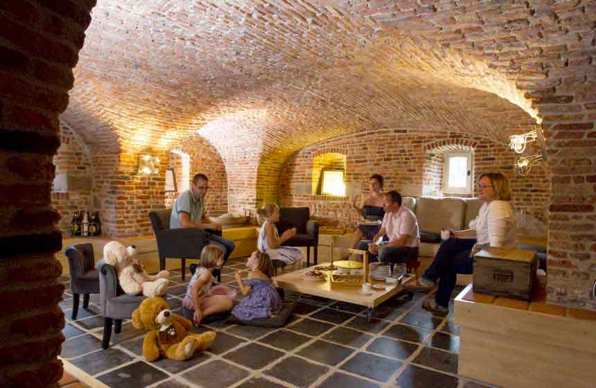 One of the best features of Manoir-du-Bolgaro in Northern France is the amazing lounge in the vaulted cellar, making it the perfect place to hold a large family weekend break