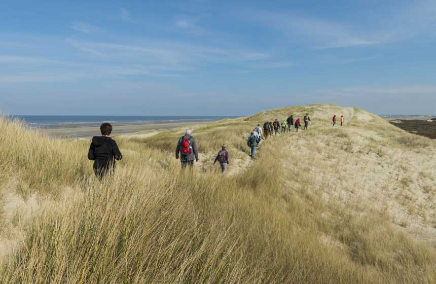 A trek across the sand-dunes with far-reaching views of the Northern France coastline