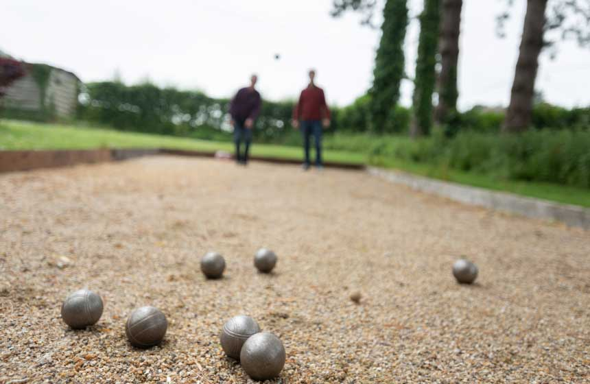 Embrace the French way of life on your family weekend break with a game of boules at your gite